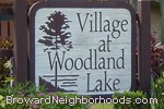 sign in front of Village At Woodland Lake in Tamarac